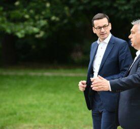 Poland's Prime Minister Mateusz Morawiecki, left, speaks with Hungary's Prime Minister Viktor Orban.