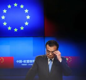 China's Premier Li Keqiang adjusts his glasses during a joint news conference with European Council 2019.