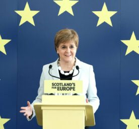 """Woman in front of """"Scotland's for Europe"""" sign"""