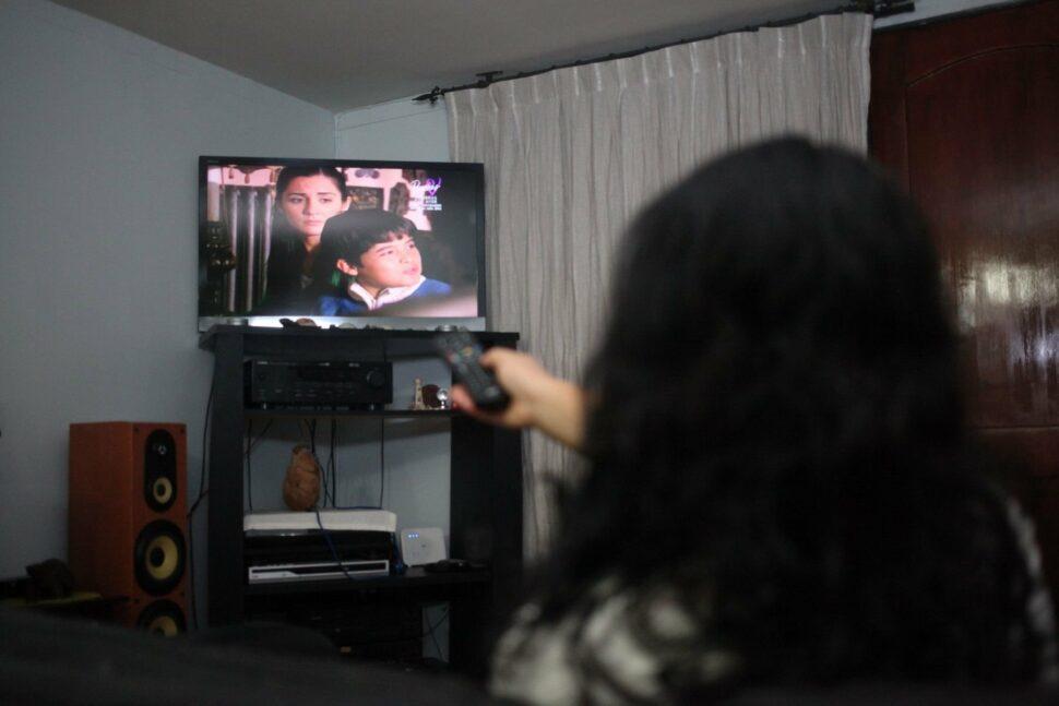 A woman watches a Turkish Soap Opera
