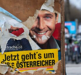 An old election poster by Heinz-Christian Strache (FPÖ) from 2008 is revealed under the torn poster.