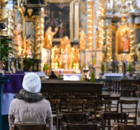 Only a few individuals seen during a mass inside the Church of St. Bernardino of Siena in Krakow.
