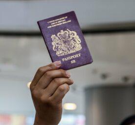 A woman holds a British passport