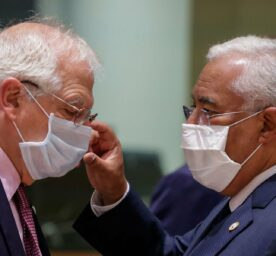 Portugal's Prime Minister Antonio Costa, right, speaks with European Union foreign policy chief Josep Borrell during a round table meeting at an EU summit in Brussels, Friday, July 17, 2020.