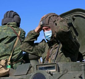 Crew members of a Strela-10 surface-to-air missile system take part in air defence drills at an army firing range of the Donetsk People's Republic.