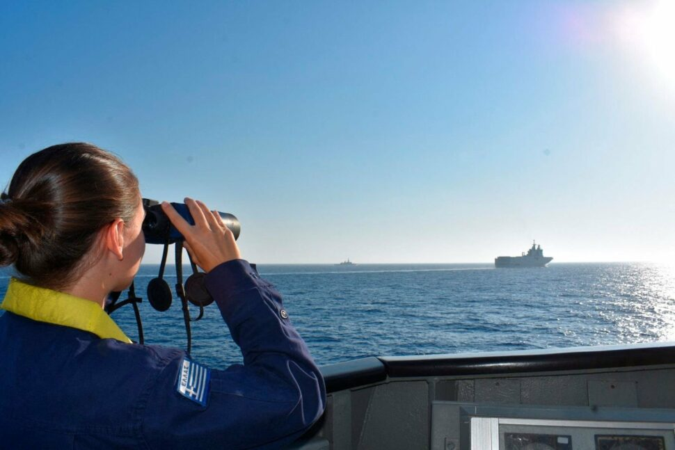A Greek Navy officer with binoculars monitors the movement of French vessels during joint excersises in the Aegean Sea.