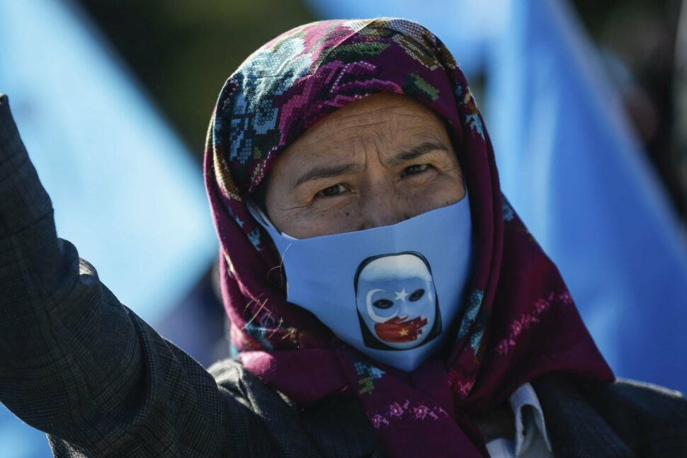 A protester from the Uighur community.