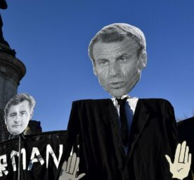 Banners of French President  Macron, Minister of the Interior Gerald Darmanin and Prefect Didier Lallement are seen during a protest in Paris.