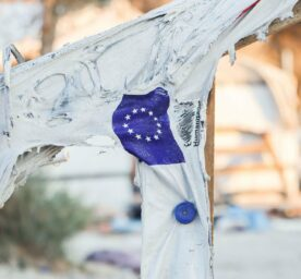 EU flag on a molten tent in Moria refugee camp after the fire.