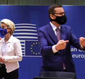 Emmanuel Macron, left, speaks with Ursula von der Leyen as Viktor Orban, right, speaks with Poland's Prime Minister in Brussels, Thursday, Dec. 10, 2020