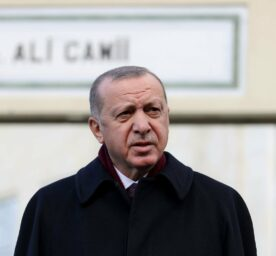 Turkish President Recep Tayyip Erdogan speaks to press members after performing the Friday prayer at Hz. Ali Mosque, in Istanbul.