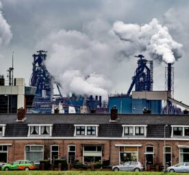 The Tata Steel Factory is polluting the air behind a neighbourhood in the village