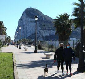People walking along the promenade in La Línea de la Concepcion by the Gibraltar