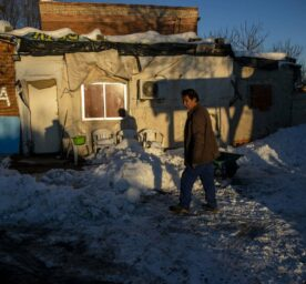 A man walks in front of his house at Canada Real powerless shanty town, outside Madrid, Spain, one of the biggest slum areas in Europe.
