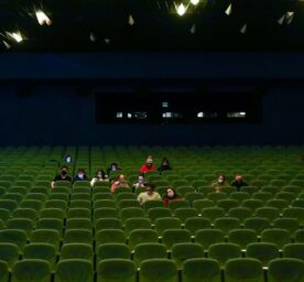 People are watching a movie in a cinema on the first day od reopening after lockdown.