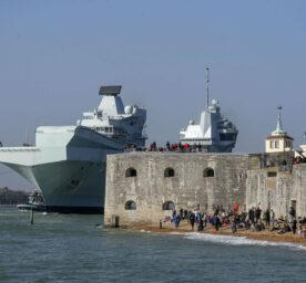 The Royal Navy aircraft carrier HMS Queen Elizabeth leaves Portsmouth Naval Base in Hampshire as it sets sail for exercises at sea.