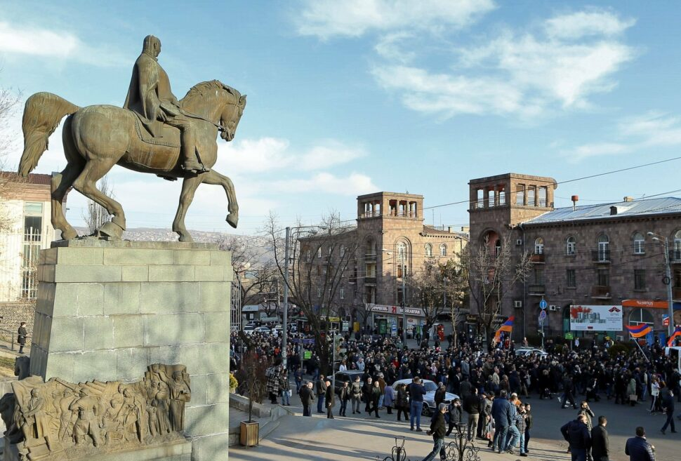 YEREVAN, ARMENIA - MARCH 6, 2021: A rally organised by the Homeland Salvation Movement, a coalition of opposition parties, near the National Assembly of Armenia. Seen at left is a statue of Marshal Hovhannes Baghramyan.