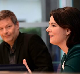The leaders of Germany's Green party Annalena Baerbock, right, and Robert Habeck attend a press conference, Habeck gazes at Baerbock