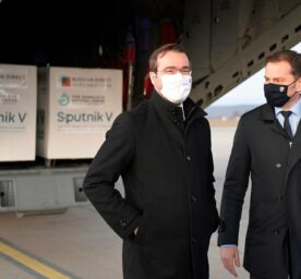 In this Monday March 1, 2021 file photo, Slovak Prime Minister Igor Matovic, right, and Health Minister Marek Krajci at Kosice Airport, Slovakia, as Russia's Sputnik V coronavirus vaccine arrives.