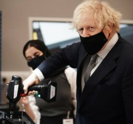 Boris Johnson visit to Lancashire. Prime Minister Boris Johnson tries out a power tool during a visit to BAE Systems at Warton Aerodrome in Lancashire, to mark the publication of the Integrated Review.