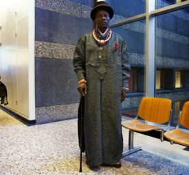 Nigerian famer Eric Dooh stands in the courthouse of The Hague, The Netherlands