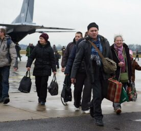 People with dual Ukrainian-Polish nationality get out of a plane as they arrive to the military aiport in Krolewo Malborskie, Poland, 13 January 2015.