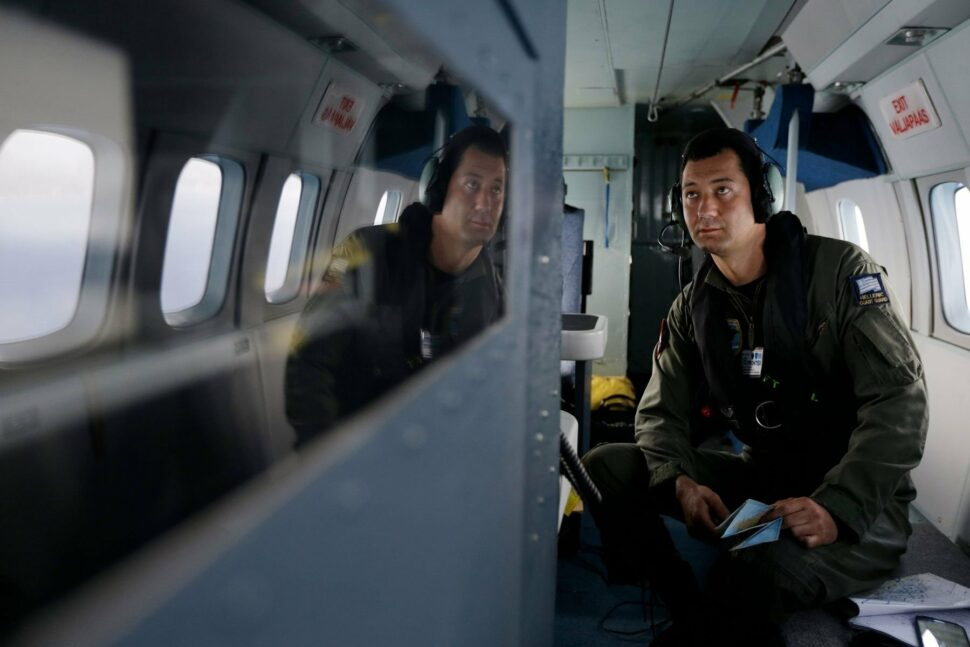 Greek Coast Guard Surveillance System Operator watches the monitors during a Frontex flight patrol operation over the Ionian Sea