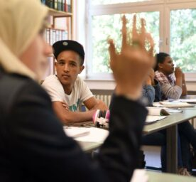 Students attend a German lesson for refugee children in Aachen