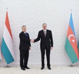 Hungarian Prime Minister Viktor Orban shakes hands with Azerbaijani President Ilham Aliyev.