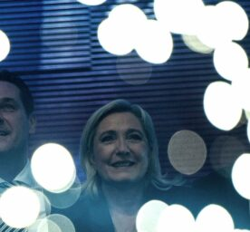 Austrian politician Heinz-Christian Strache and French politician Marine Le Pen are cheering at the 'Public meeting on patriotic spring'.