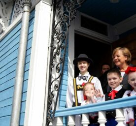 German Chancellor Angela Merkel laughs with Russian children in front of the Russian-German House in Tomsk in 2006.