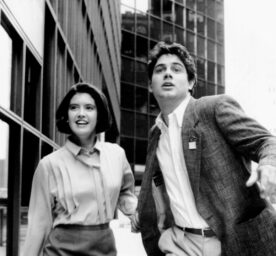 Actors Phoebe Cates and Zach Galligan look hopefully in 1990