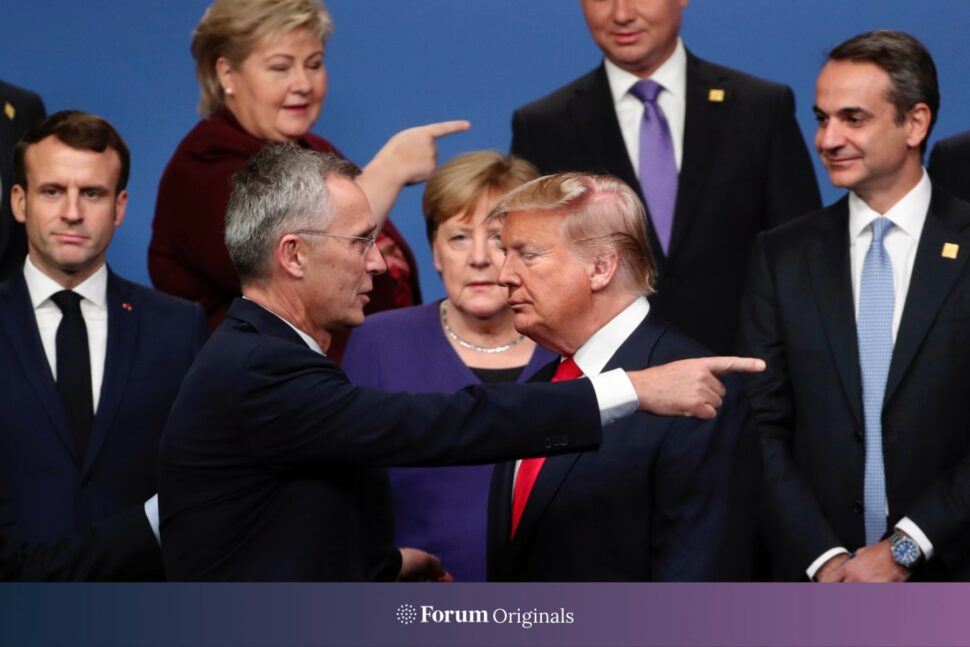 NATO Secretary General Jens Stoltenberg, front left, speaks with ex U.S. President Donald Trump, front right, after a group photo at a NATO leaders meeting
