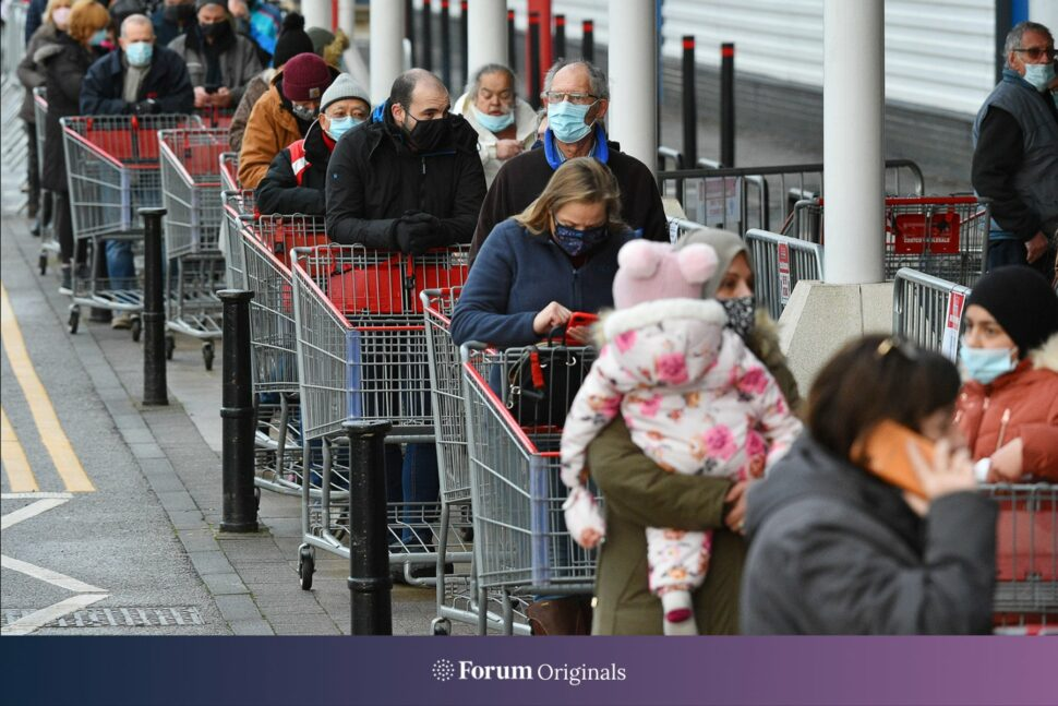 People in a queue to a supermarket
