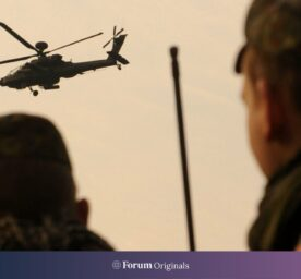German Bundeswehr troops take part in a Close Air Support exercise with a US Apache helicopter in preparation for a deployment in Afgahnistan at the military exercise centre in Letzingen, Germany, May 2011