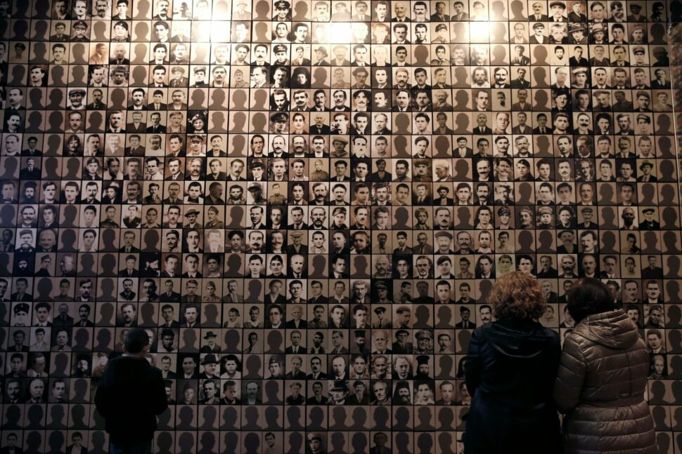 Visitors look at portraits of victims at the Holocaust Museum in the town of Kalavryta, western Greece.