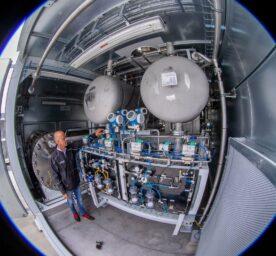 Engineer checks on hydrogen power plant