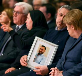 Federal Chancellor Angela Merkel and relatives of the victims attend the memorial service for the victims of the Hanau attack