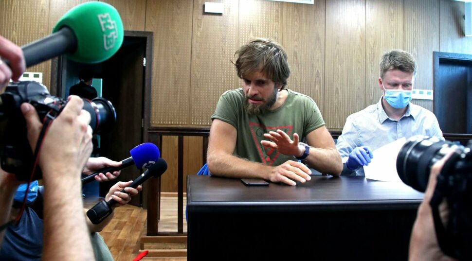 MediaZona owner Pyotr Verzilov and his lawyer Leonid Solovyov attend a hearing at Moscow's Meshchansky District Court