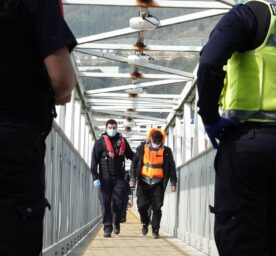 Mar 25, 2021 - Dover, England, UK: Border guards intercepting an illegal migrant that has just crossed from France.