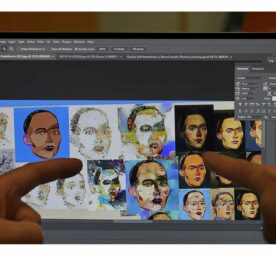 David Hanson shows the Sophia's digital artwork on a laptop at his studio in Hong Kong on March 29, 2021.
