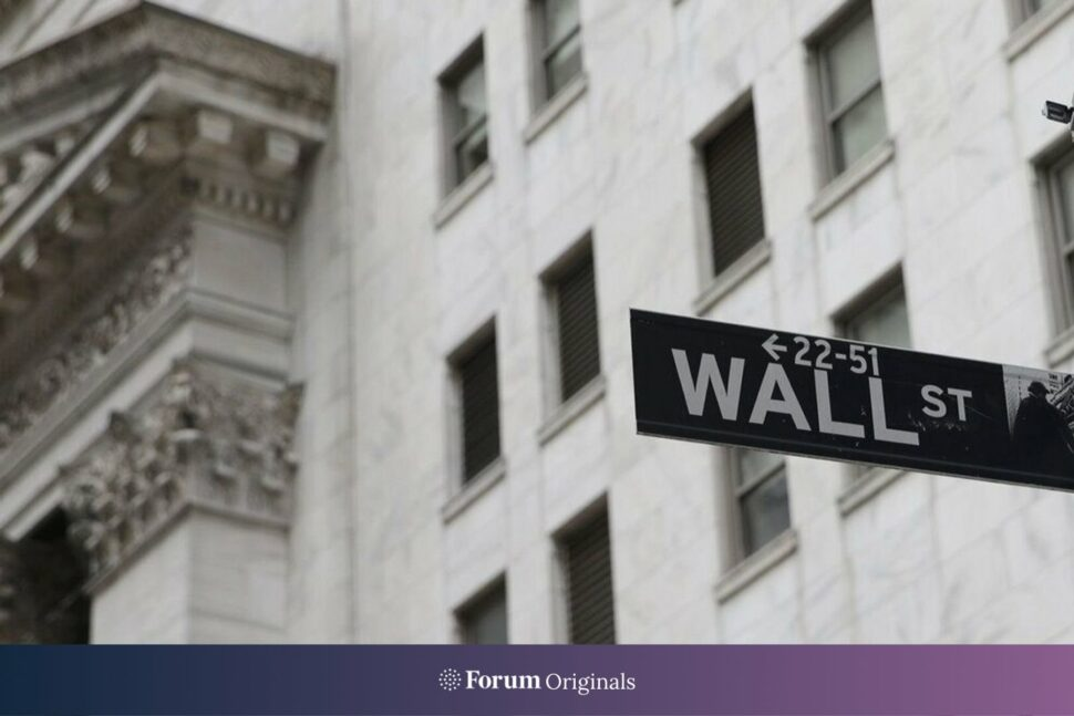 A sign for Wall Street hangs outside of the New York Stock Exchange