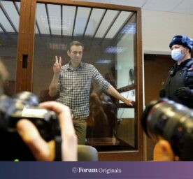 Russian opposition leader Alexei Navalny stands in a cage in the Babuskinsky District Court in Moscow, Russia, Saturday, Feb. 20, 2021.