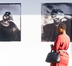 People view silkscreen print photographs by the late British-Gambian photographer Khadija Saye at an installation at Westbourne Grove, London, England, UK on Tuesday 7 July, 2020. Saye died in the Grenfell Tower fire. Picture by Justin Ng/UPPA/Avalon