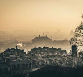 A city veiw of Paris in the mist.