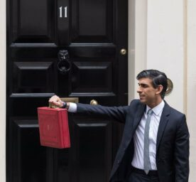 LONDON, UNITED KINGDOM - MARCH 03, 2021: Chancellor of the Exchequer Rishi Sunak holds the Budget box outside 11 Downing Street in central London.