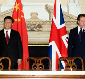 British Prime Minister David Cameron, right, stands with China's President Xi Jinping, at the UK-China Business Summit in Mansion House, central London, Wednesday, Oct. 21, 2015, on the second day of the president's state visit.